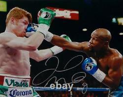 Floyd Mayweather Autographed 16x20 vs Canelo Alvarez Photo- Beckett Auth Silver