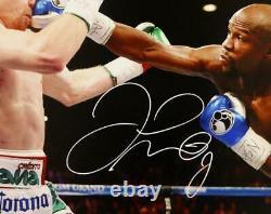 Floyd Mayweather Autographed 16x20 vs Canelo Alvarez Photo- Beckett Auth White